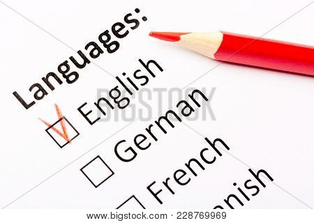 Questionnaire Concept. Languages With English, German, French, Spanish Checkboxes With Red Pencil. C