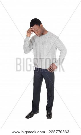 An African American Man Standing Isolated For White Background With One Hand On His Forehead, Lookin
