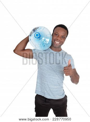 A Young Smiling African American Man Carrying A Blue Big Water Bottle On His Shoulder With Thump Up,