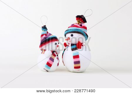 two Snowman on white. Christmas background.