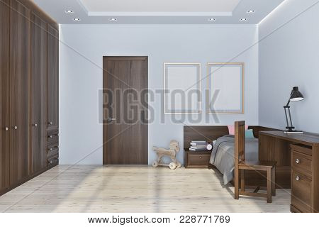 Nursery Interior With A Wooden Floor And White Walls, A Massive Wooden Wardrobe And A Desk With A Ch