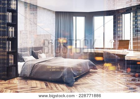 Modern Bedroom And Home Office Corner With Concrete And Gray Walls, A Wooden Floor, A Master Bed And