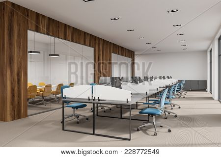 White And Wooden Office Interior With White Tables, Computers On Them And Blue, Yellow And Red Chair