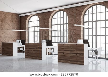 Brick Open Space Office Corner With Arch Windows, A Concrete Floor And Cubicles. A Close Up 3d Rende