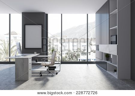 Gray Modern Office Workplace Interior With A Bookcase, A Computer Table And An Office Chair. A Poste