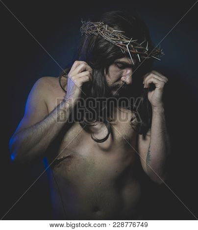 Jesus of Nazareth, representation of the Calvary of Jesus, son of God. He has the wound on his side and the crown of thorns