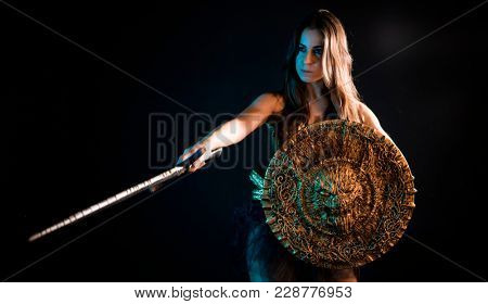 Medieval, valkyrie warrior, woman with golden armor iron coat and big warrior sword