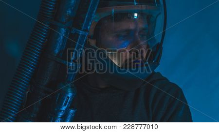 Galaxy space man with led lights helmet, space suit and gun in the shape of a cannon