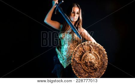 Knight valkyrie warrior, woman with golden armor iron coat and big warrior sword