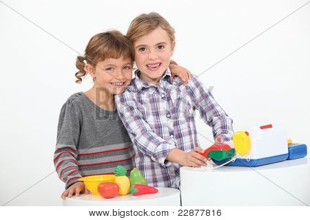 portrait of two children playing poster