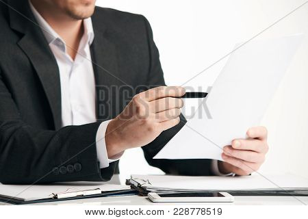 Businessman Working With The Agreement Documents In His Office. Business Man Hand Signing A Contract