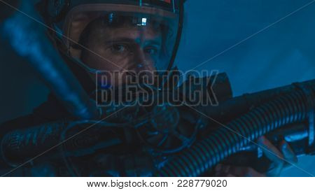 Gravity space man with led lights helmet, space suit and gun in the shape of a cannon