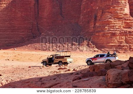 Wadi Rum, Jordan - May 11, 2013: Touristic Jeeps In Wadi Rum Desert In Jordan. Wadi Rum Also Known A