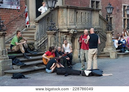 Gdansk, Poland - June 07, 2014: Unknown Street Musicians In The Historical Part Of Gdansk In The Dlu