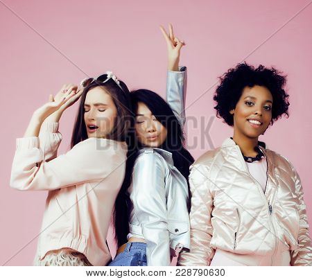 Different Nation Girls With Diversuty In Skin, Hair. Scandinavian, African American Cheerful Emotion