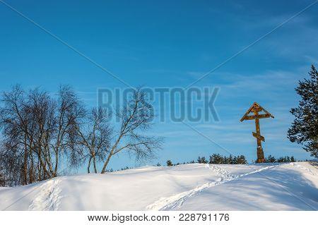Praying Cross On The Holy Irinarkhovo Spring On A Sunny Winter Day.