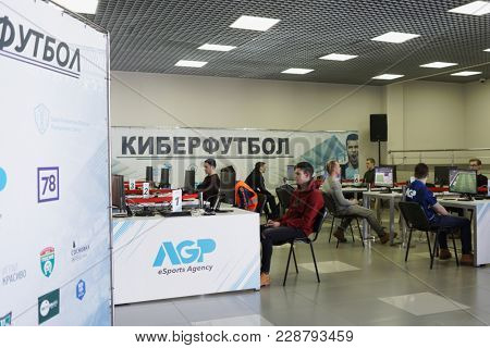 ST. PETERSBURG, RUSSIA - FEBRUARY 22, 2018: Gamers in the cyber-football zone during St. Petersburg Cyber-Sport Festival. Main event of the festival is the Counter-Strike: Global Offensive tournament