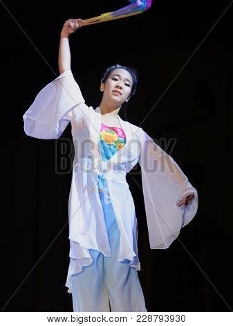SAINT-PETERSBURG, RUSSIA - FEBRUARY 6, 2018: Liu Li Heng performs the dance with fan during the Dance festival of young people of China and Russia. Six choreographic groups take part in the event