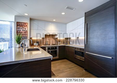 Modern Spacious Chef's Kitchen Design With White And Black Accents