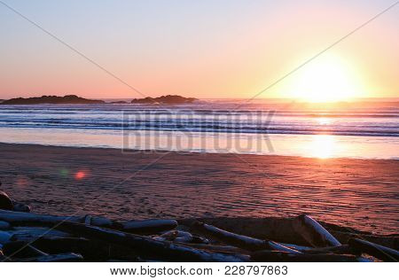 Sunset And Crashing Waves On The Beach At Long Beach, Tofino, British Columbia