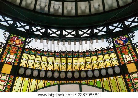 Prague, Czech Republic - October 9, 2017: The Art Nouveau stained glass facade of the Municipal House in Prague