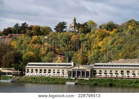 Prague, Czech Republic - October 8, 2017: Thai restaurant on the riverside of the Vltava River in autumn