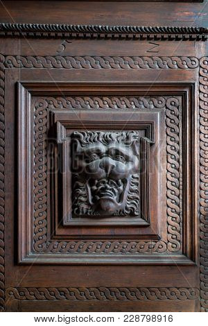 Prague, Czech Republic - October 9, 2017: Old Town City Hall, Staromestske Namesti, door with wood carvings of lion head with a mans head in his mouth