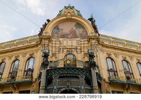 Prague, Czech Republic - October 9, 2017: The Art Nouveau building Municipal House in Prague with gold trimmings, stained glass  and sculpture