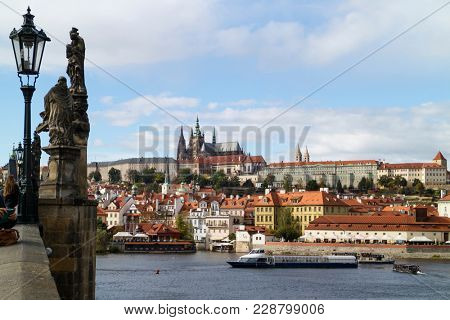 Prague; Czech Republic - October, 6, 2017: Prague castle seen from the Charles Bridge with the river Moldau and ships