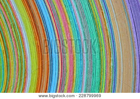 Close up shot of stack of colorful papers