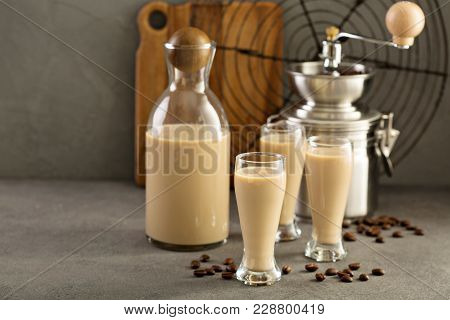 Homemade Irish Cream And Coffee Liquor In A Bottle And Shot Glasses