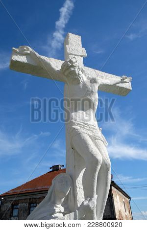GORA, CROATIA - JUNE 18: Crucifixion, Virgin Mary under the Cross in front Parish Church of Assumption of the Virgin Mary in Gora, Croatia on June 18, 2016.