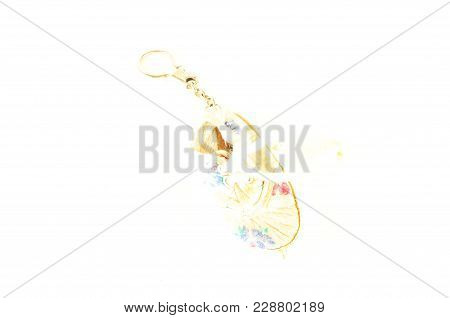 Close-up Of Shoe Keyring Object On A White Background