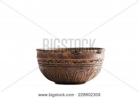Antic Glued Bowl. Isolated On The White Background.