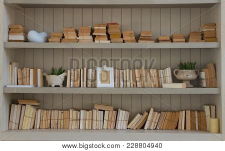 Many Blank Cover Book On White Wood Vintage Shelf  With Home Decorate.