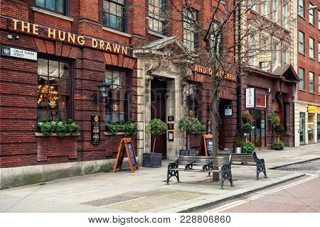 LONDON, UK - JANUARY 12, 2016: Famous historic Hung Drawn & Quartered pub in London - capital and most populous city of United Kingdom, popular tourist destination.