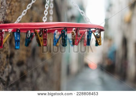 Old White Plastic Clothespins Hang On The Street