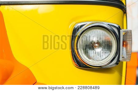 Headlight Of Old Vehicle Close Up Shot - Car Of Primrose Yellow Color