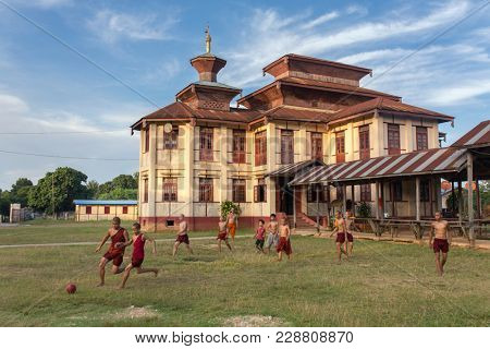 Hsipaw, Myanmar - October 7, 2016: Unidentified burmese buddhist monks plays soccer near the monastery in Hsipaw, Burma