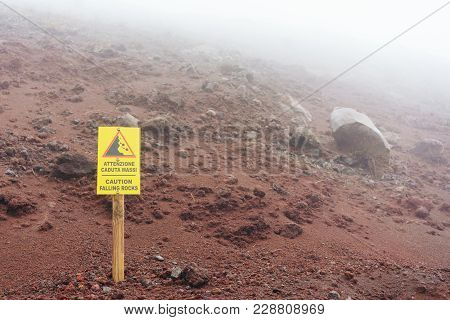 Warning Sign On The Mountainside, Caution Falling Rosks