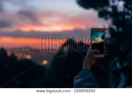 Young Woman Taking Photo With Her Phone