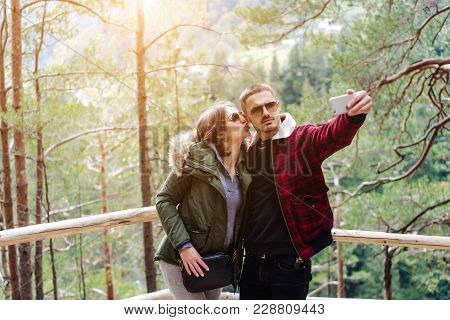 Man And Woman In The Forest Take Selfie In The Woods