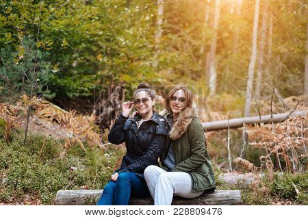 Two Beautiful Girls Sat Down To Rest In The Forest