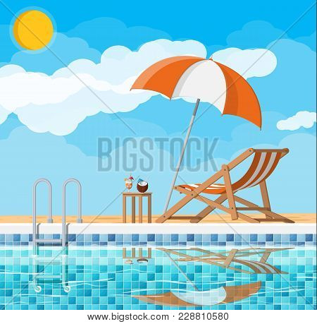 Swimming Pool And Ladder. Umbrella, Wooden Lounger. Table With Coconut And Cocktail. Sky, Clouds, Su