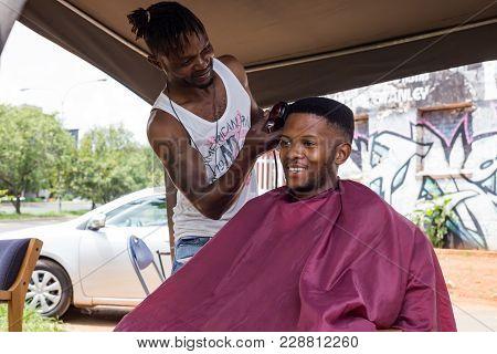 Johannesburg, South Africa, February 14, 2018:  Man Having Haircut In An Informal Barber Shop.