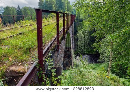 Viaduct Across The River Yaryngya. Krestetsky District, Novgorod Region Russia. The Bridge Was Built