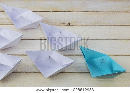 Leadership Concept With Blue Paper Ship On Wood.