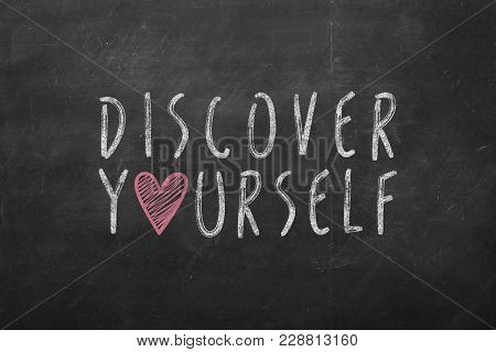 Discover Yourself Text Hand-written On Black Chalkboard.