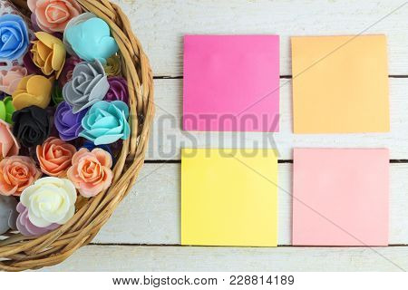 Basket Flowers And Empty Paper Sticky Notes For Text.