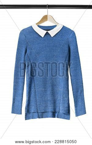 Blue Knitted Sweater With White Collar Hanging On Clothes Rack Isolated Over White